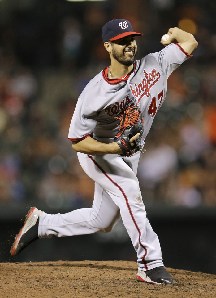 Photo - Washington Nationals starting pitcher Gio Gonzalez throws to the Baltimore Orioles in the sixth inning of an interleague baseball game, Thursday, July 10, 2014, in Baltimore. (AP Photo/Patrick Semansky)