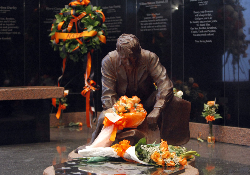 Flowers lay on a memorial statue  before the basketball game between Oklahoma State and Texas, Wednesday, Jan. 26, 2011, at Gallagher-Iba Arena in Stillwater, Okla. Photo by Sarah Phipps, The Oklahoman