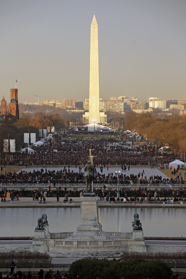 The crowd starts to fill up the National Mall early in the morning before the ceremonial swearing-in of President Barack Obama at the U.S. Capitol during the 57th Presidential Inauguration in Washington, Monday, Jan. 21, 2013. (AP Photo/Pablo Martinez Monsivais)