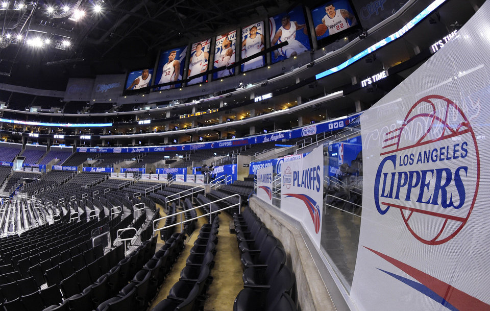 Photo - Signs and photos adorn Staples Center before Game 5 of an opening-round NBA basketball playoff series between the Los Angeles Clippers and the Golden State Warriors, Tuesday, April 29, 2014, in Los Angeles. (AP Photo)