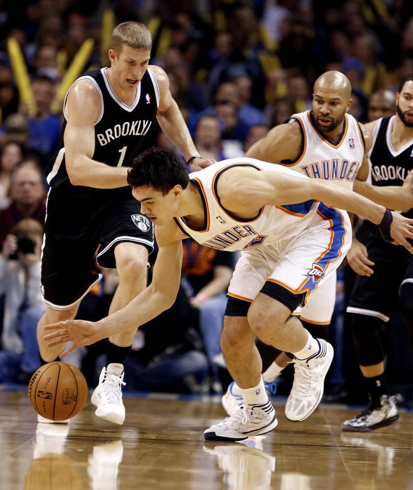 Photo - Thunder's Steven Adams (12) picks up a ball knocked loose by Derek Fisher in the first half of an NBA basketball game where the Oklahoma City Thunder were defeated 95-93 by the Brooklyn Nets at the Chesapeake Energy Arena in Oklahoma City, on Thursday, Jan. 2, 2014. Photo by Steve Sisney The Oklahoman