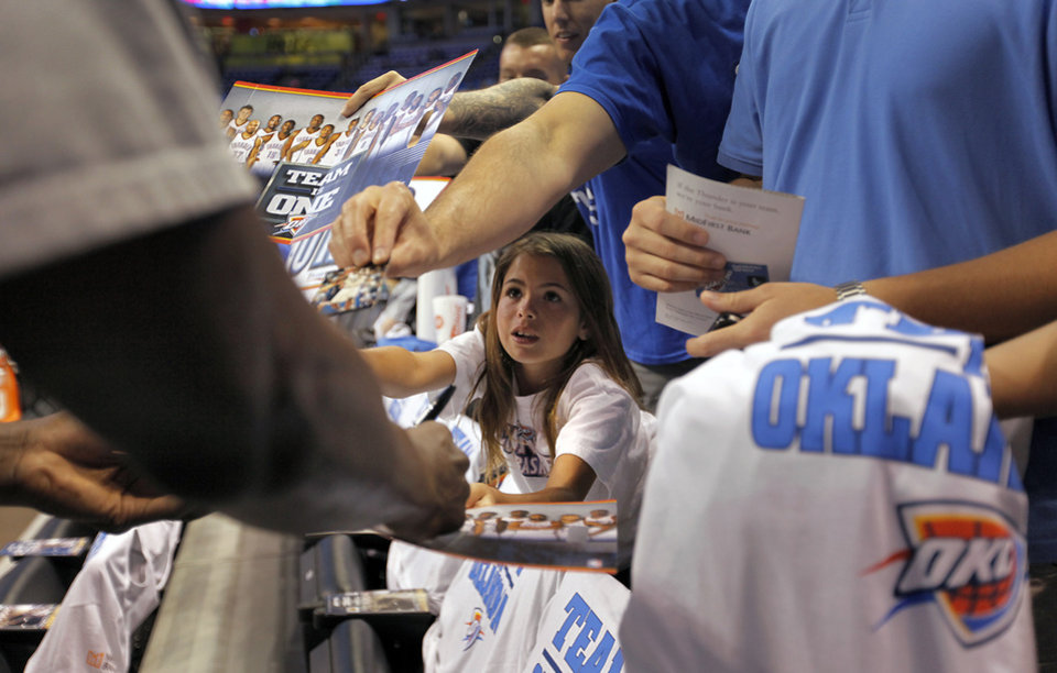 Payton James, 9, tries to get player autographs during Game 2 in the second round of the NBA playoffs between the Oklahoma City Thunder and the L.A. Lakers at Chesapeake Energy Arena on Tuesday,  May 15, 2012, in Oklahoma City, Oklahoma. Photo by Chris Landsberger, The Oklahoman