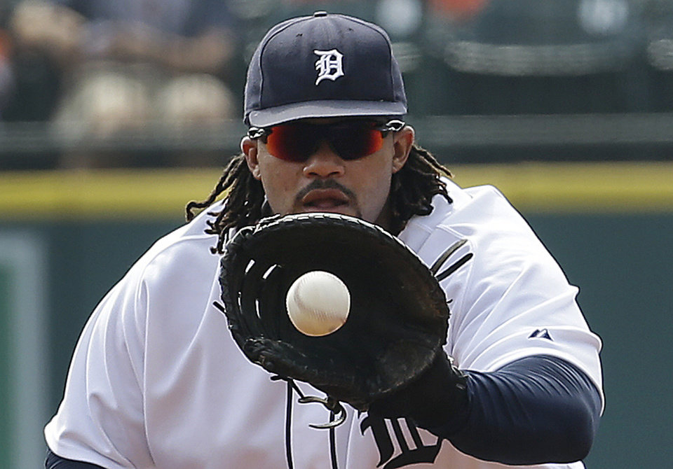 Detroit Tigers first baseman Prince Fielder fields a ground ball hit by Seattle Mariners\' Michael Saunders in the first inning of a baseball game in Detroit, Thursday, Sept. 19, 2013. Saunders was out on the play. (AP Photo/Paul Sancya)