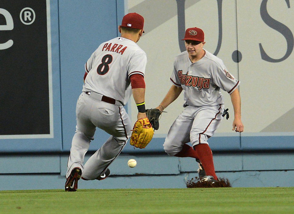 Photo - Arizona Diamondbacks right fielder Gerardo Parra (8) and center fielder Tony Campana chase down the ball on a double by Los Angeles Dodgers' Dan Haren in the fourth inning of a baseball game Saturday, June 14, 2014, in Los Angeles. (AP Photo/Jayne Kamin-Oncea)