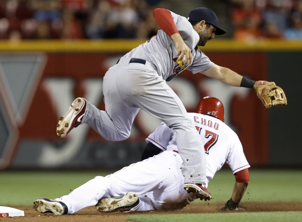 Photo - Cincinnati Reds' Shin-Soo Choo (17) slides hard into second base after being force, causing St. Louis Cardinals second baseman Matt Carpenter to hold on to the ball in the sixth inning of a baseball game, Tuesday, Sept. 3, 2013, in Cincinnati. Joey Votto was safe at first. (AP Photo/Al Behrman)