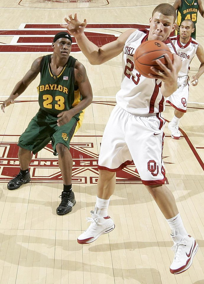 Photo - OU's Blake Griffin grabs a rebound in front of Baylor's Kevin Rogers during the Big 12 college basketball game between the University of Oklahoma and Baylor University in Norman, Okla., Saturday, Jan. 24, 2009. PHOTO BY BRYAN TERRY, THE OKLAHOMAN ORG XMIT: KOD