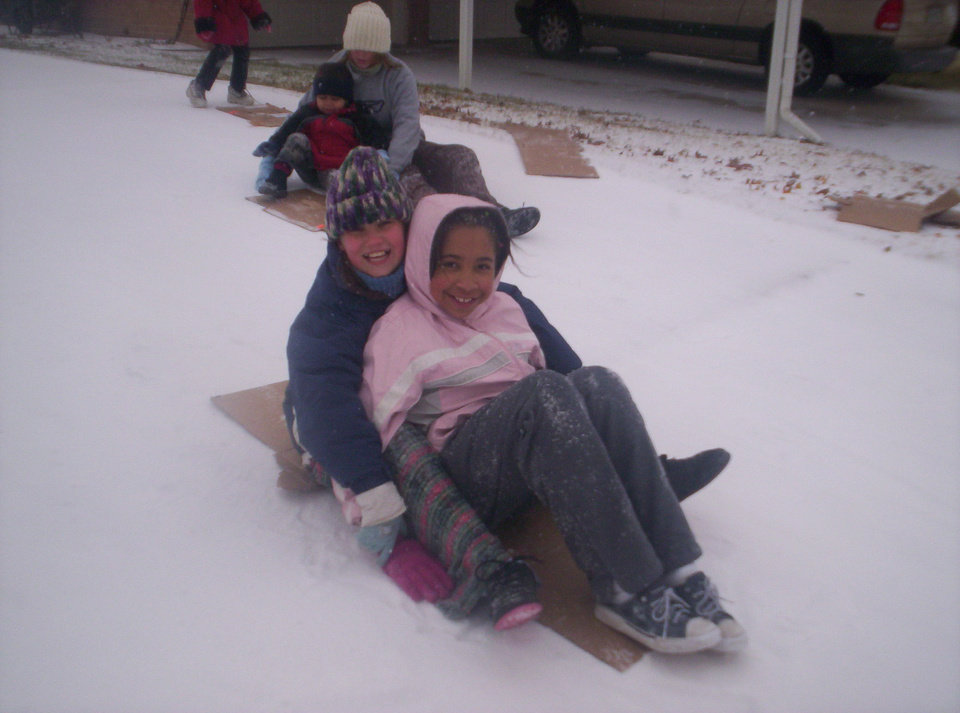Lexi and Jodey from Midwest City sledding down a drive-way!<br/><b>Community Photo By:</b> Leah Albright<br/><b>Submitted By:</b> Leah, Midwest City