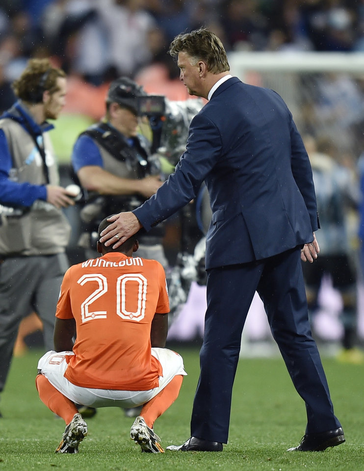 Photo - Netherlands' head coach Louis van Gaal consoles Netherlands' Georginio Wijnaldum after a shootout at the end of the World Cup semifinal soccer match between the Netherlands and Argentina at the Itaquerao Stadium in Sao Paulo Brazil, Wednesday, July 9, 2014. Argentina won 4-2 on penalties after the match ended 0-0 after extra time.  (AP Photo/Martin Meissner)