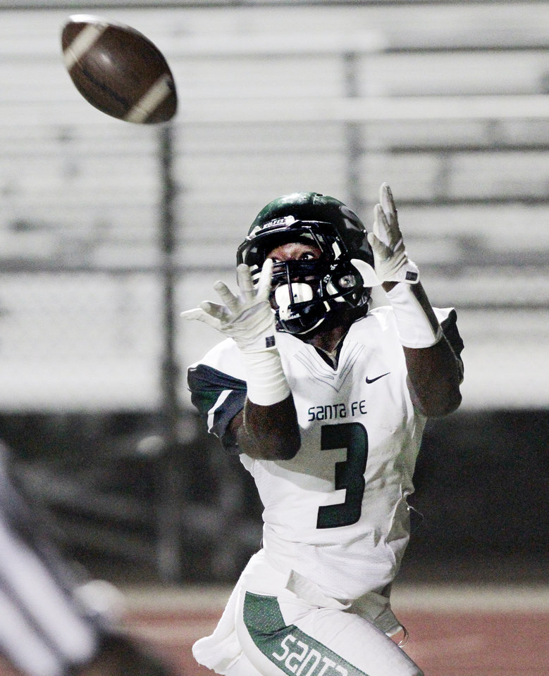 Santa Fe's Cornelius Fugett catches a pass in the end zone for a touchdown in high school football as the Norman High School Tigers play the Edmond Santa Fe  Wolves on Friday, Oct. 19, 2012 in Norman, Okla.  Photo by Steve Sisney, The Oklahoman