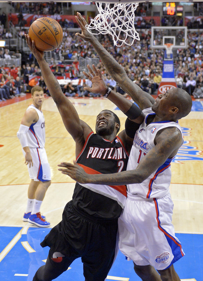 Photo - Portland Trail Blazers guard Wesley Matthews, left, puts up a shot as Los Angeles Clippers guard Jamal Crawford defends during the first half of an NBA basketball game, Sunday, Jan. 27, 2013, in Los Angeles. (AP Photo/Mark J. Terrill)