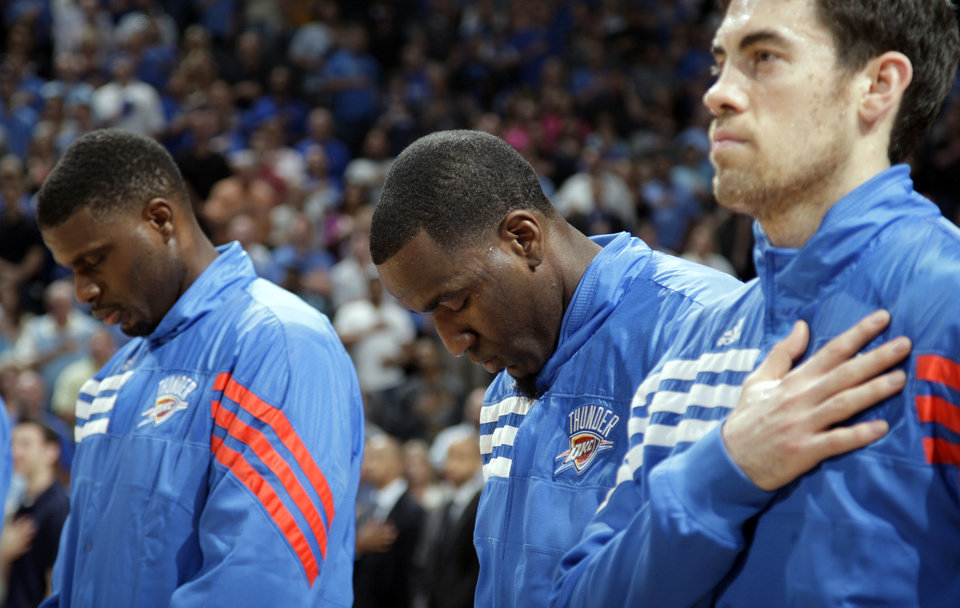 Photo - Oklahoma City's Nazr Mohammed (8), Kendrick Perkins (5) and Nick Collison (4) pray during the NBA basketball game between the Miami Heat and the Oklahoma City Thunder at Chesapeake Energy Arena in Oklahoma City, Sunday, March 25, 2012. Photo by Sarah Phipps The Oklahoman