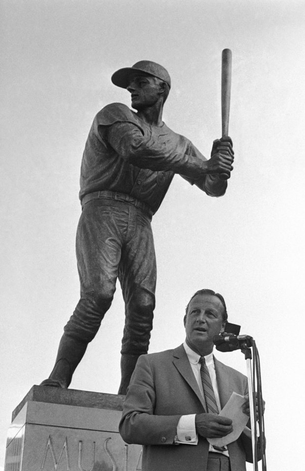 FILE - In this Aug. 4, 1968, file photo, former St. Louis Cardinals baseball player Stan Musial stand near a statue of him at the plate, outside Busch Stadium in St. Louis. Musial, one of baseball\'s greatest hitters and a Hall of Famer with the Cardinals for more than two decades, has died. He was 92. Stan the Man won seven National League batting titles, was a three-time MVP and helped the Cardinals capture three World Series championships in the 1940s. The Cardinals announced Musial\'s death in a news release. They said he died Saturday evening, Jan. 19, 2013, at his home surrounded by family. (AP Photo/Fred Waters, File)