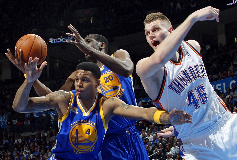 Golden State's Ekpe Udoh (20) and Brandon Rush (4) along wth Oklahoma City's Cole Aldrich (15) try to grab a rebound during the NBA basketball game between the Oklahoma City Thunder and the Golden State Warriors at the Chesapeake Energy Arena in Oklahoma City, Friday, Feb. 17, 2012. The Thunder won, 110-87. Photo by Nate Billings, The Oklahoman