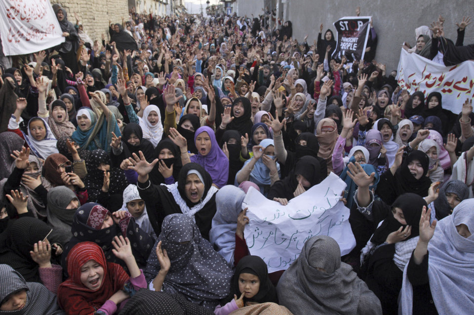 Pakistani Shiite Muslim women chant slogans during a protest to condemn Saturday\'s bombing, in Quetta, Pakistan, Sunday, Feb. 17, 2013. Angry residents on Sunday demanded government protection from an onslaught of attacks against Shiite Muslims, a day after scores of people were killed in a massive bombing that a local official said was a sign that security agencies were too scared to do their jobs. (AP Photo/Arshad Butt)