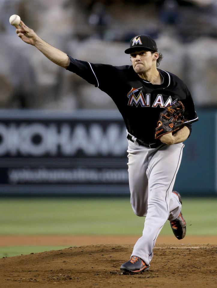 Photo - Miami Marlins starting pitcher Nathan Eovaldi throws against the Los Angeles Angels during the first inning of a baseball game in Anaheim, Calif., Tuesday, Aug. 26, 2014. (AP Photo/Chris Carlson)
