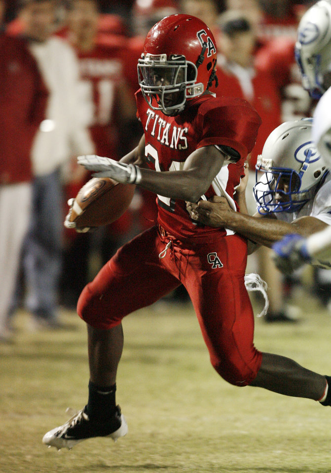 Carl Albert's David Oku runs around a Guthrie player in high school football at Jim Harris Stadium  in Midwest City, Oklahoma on Thursday October 16, 2008.  