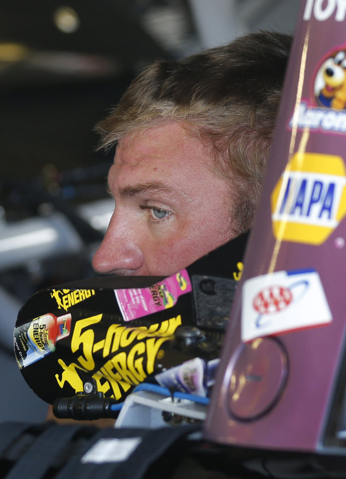 Photo - Driver Clint Bowyer sits in his car during practice for Sunday's NASCAR Sprint Cup series auto race at Kansas Speedway in Kansas City, Kan., Friday, Oct. 4, 2013. (AP Photo/Orlin Wagner)