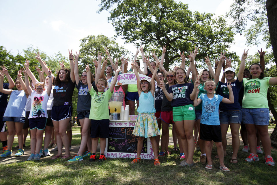 Vivienne Harr, 9, of Fairfax, Calif., and members of the Shawnee community gather around her Make A Stand lemonade stand. Photo by Aliki Dyer, The Oklahoman <strong>Aliki Dyer - The Oklahoman</strong>