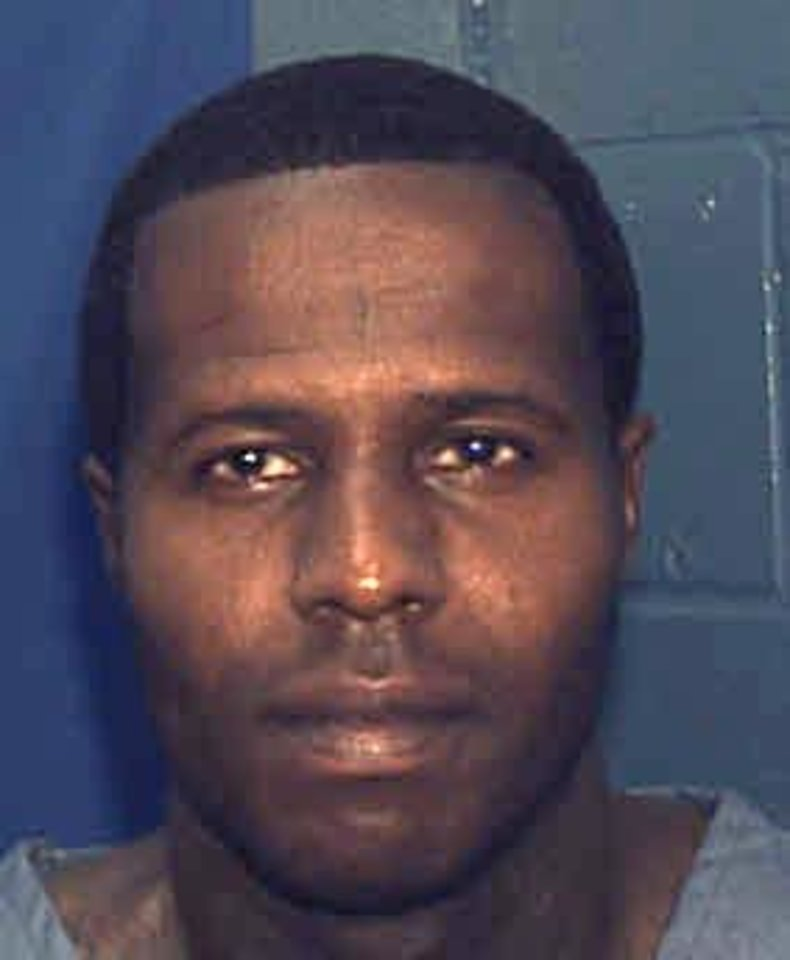 Photo - This undated photo made available by the Florida Department of Corrections shows Charles Walker. Walker and Joseph Jenkins were mistakenly released from prison in Franklin County, Fla.,  in late September and early October.  According to authorities, the the two convicted murderers were released with forged documents. A manhunt is under way for the two men. (AP Photo/Florida Dept. of Corrections,HO)
