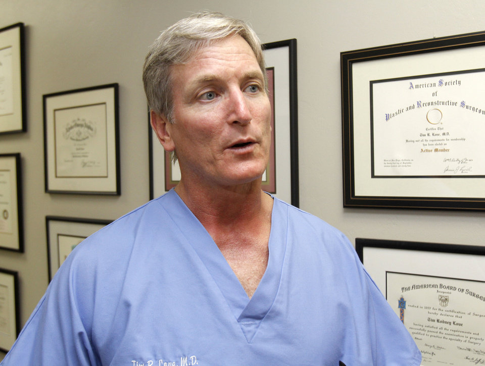 Photo - Dr. Tim Love discusses hair follicle transplant at his office in Oklahoma City, OK, Monday, August 20, 2012,  By Paul Hellstern, The Oklahoman