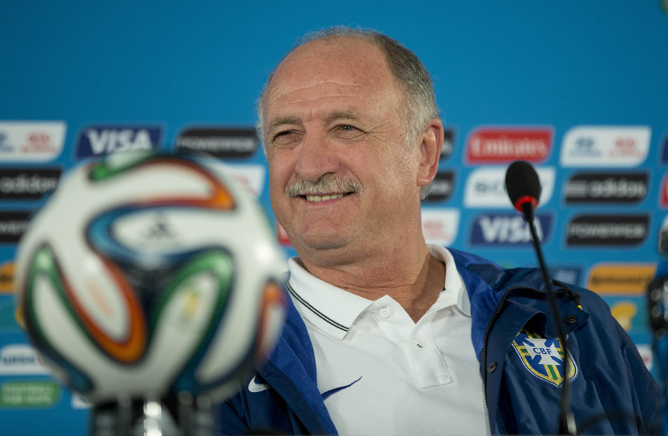 Photo - Brazil's coach Luiz Felipe Scolari smiles during a press conference one day before his team's World Cup third-place soccer match against the Netherlands at the Estadio Nacional in Brasilia, Brazil, Friday, July 11, 2014. (AP Photo/Andre Penner)