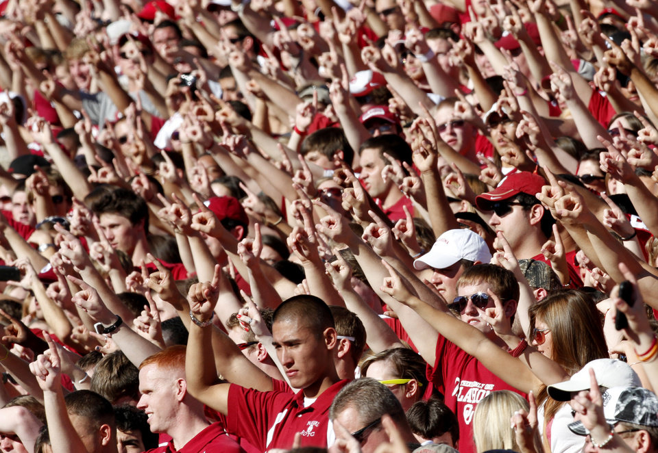 Photo - Fans cheer for OU during the first half of the college football game between the University of Oklahoma Sooners (OU) and Utah State University Aggies (USU) at the Gaylord Family-Oklahoma Memorial Stadium on Saturday, Sept. 4, 2010, in Norman, Okla.   Photo by Bryan Terry, The Oklahoman