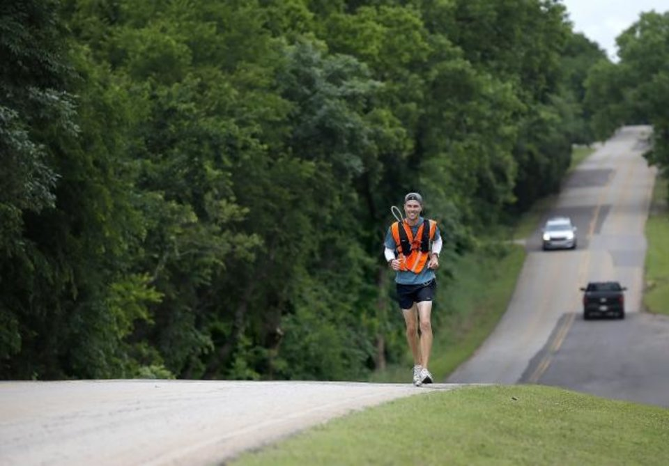 Photo -  James Strahorn is trying to become the first person to run across Oklahoma from north to south.  [Sarah Phipps/The Oklahoman]