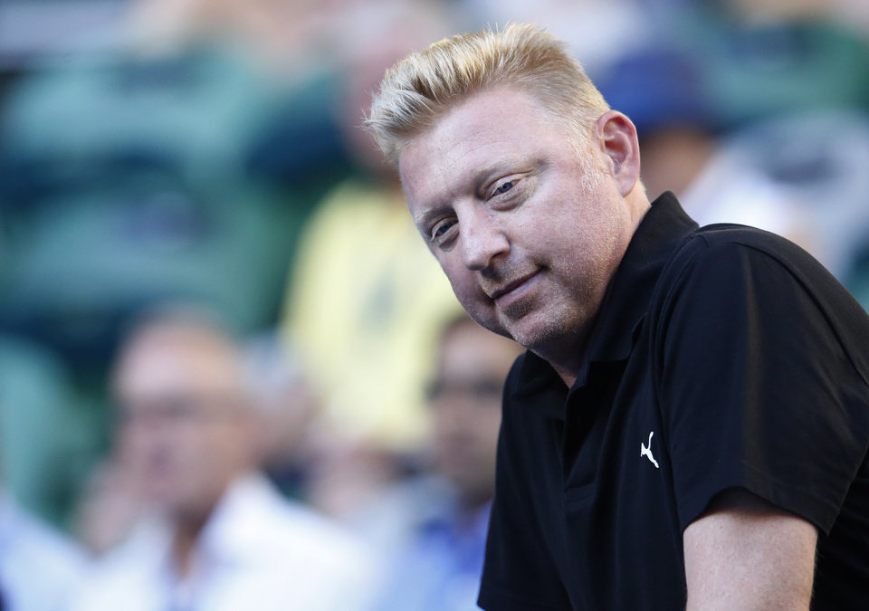 Photo - Former Grand Slam champion Boris Becker of Germany looks down onto Rod Laver Arena as he prepares to watch defending champion Novak Djokovic in his match against Slovakia's Lukas Lacko at the Australian Open tennis championship in Melbourne, Australia, Monday, Jan. 13, 2014.(AP Photo/Eugene Hoshiko)