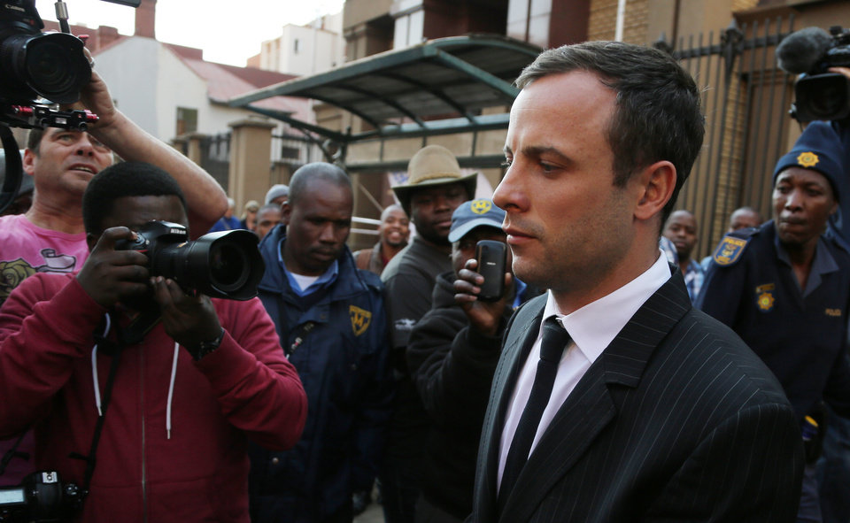Photo - Oscar Pistorius leaves the high court in Pretoria, South Africa, Friday, Aug. 8, 2014. The judge in the murder trial of Oscar Pistorius says she will give a verdict on Sept. 11. (AP Photo/Themba Hadebe)