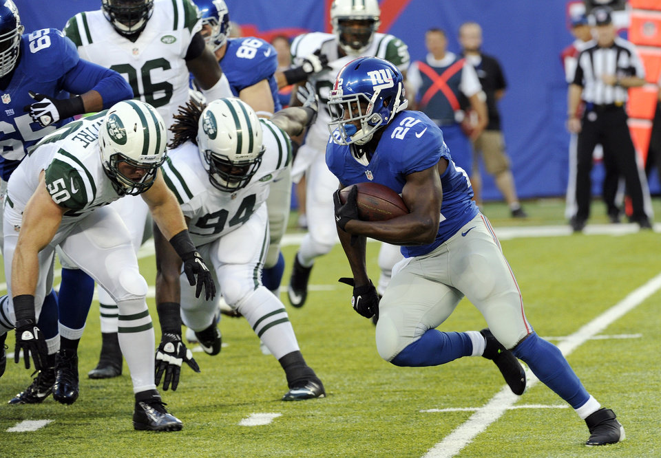 Photo - New York Giants running back David Wilson (22) rushes for a touchdown during the first half of a preseason NFL football game against the New York Jets, Saturday, Aug. 24, 2013, in East Rutherford, N.J. (AP Photo/Bill Kostroun)