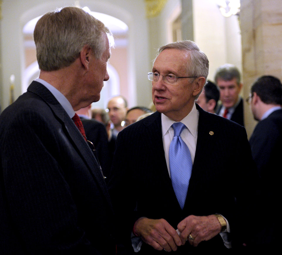 Senate Majority Leader Harry Reid of Nev., left, talks with Sen.-elect Angus King, I-Maine on Capitol Hill in Washington, Wednesday, Nov. 14, 2012. King said Wednesday he has decided to caucus with Democrats, which will add to the party�s voting edge. (AP Photo/Susan Walsh)