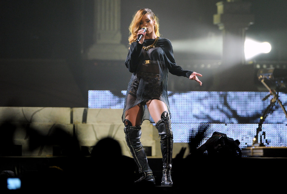 Photo -  Singer Rihanna performs at the Barclays Center on Tuesday, May 7, 2013 in New York. (Photo by Evan Agostini/Invision/AP) ORG XMIT: NYEA104