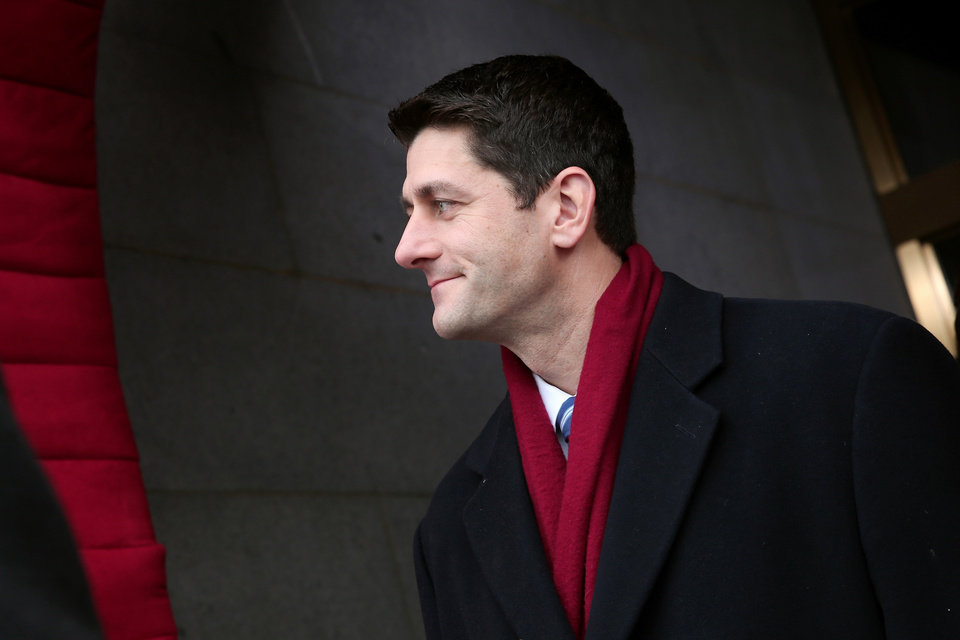 Photo - House Budget Committee Chairman Rep. Paul Ryan, R-Wis. arrives on the West Front of the Capitol in Washington, Monday, Jan. 21, 2013, for the Presidential Barack Obama's ceremonial swearing-in ceremony during the 57th Presidential Inauguration.  (AP Photo/Win McNamee, Pool)