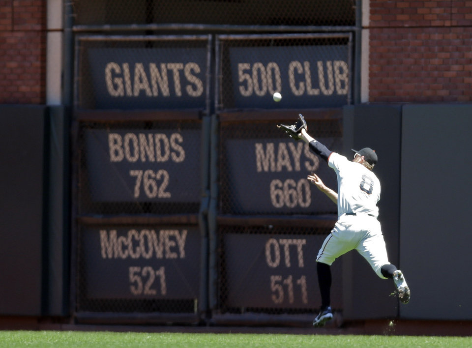 Photo - San Francisco Giants right fielder Hunter Pence cannot make a catch on a line drive by Miami Marlins' Placido Polanco during the second inning of a baseball game on Saturday, June 22, 2013, in San Francisco. Polanco got a double on the play. (AP Photo/Marcio Jose Sanchez)