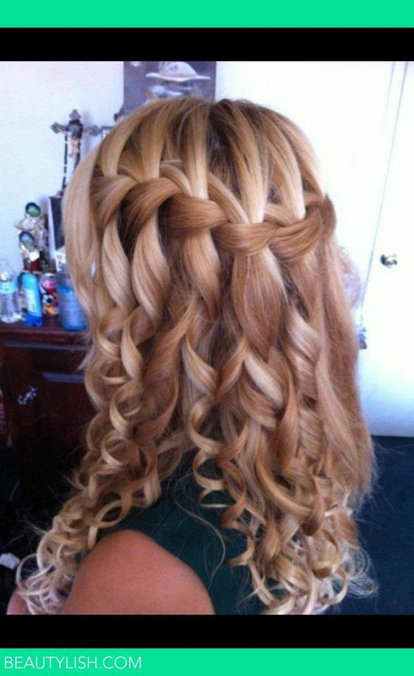 Photo -  For a romantic visage, perfect for a wedding or prom, try an automatic curling system like the BaByliss Pro MiraCurl Machine. While it's a little tricky to use and takes practice, once you get it, you can create a full head of beautiful spirals in no time. Bonus: It's fun to use. After curling all your hair, weave in a waterfall braid across the back of the crown. Waterfall braids are the newest braid trend. They're softer and less structured than regular French braids. Try Youtube for instructional videos on creating waterfall braids. Photo from Pinterest.com.