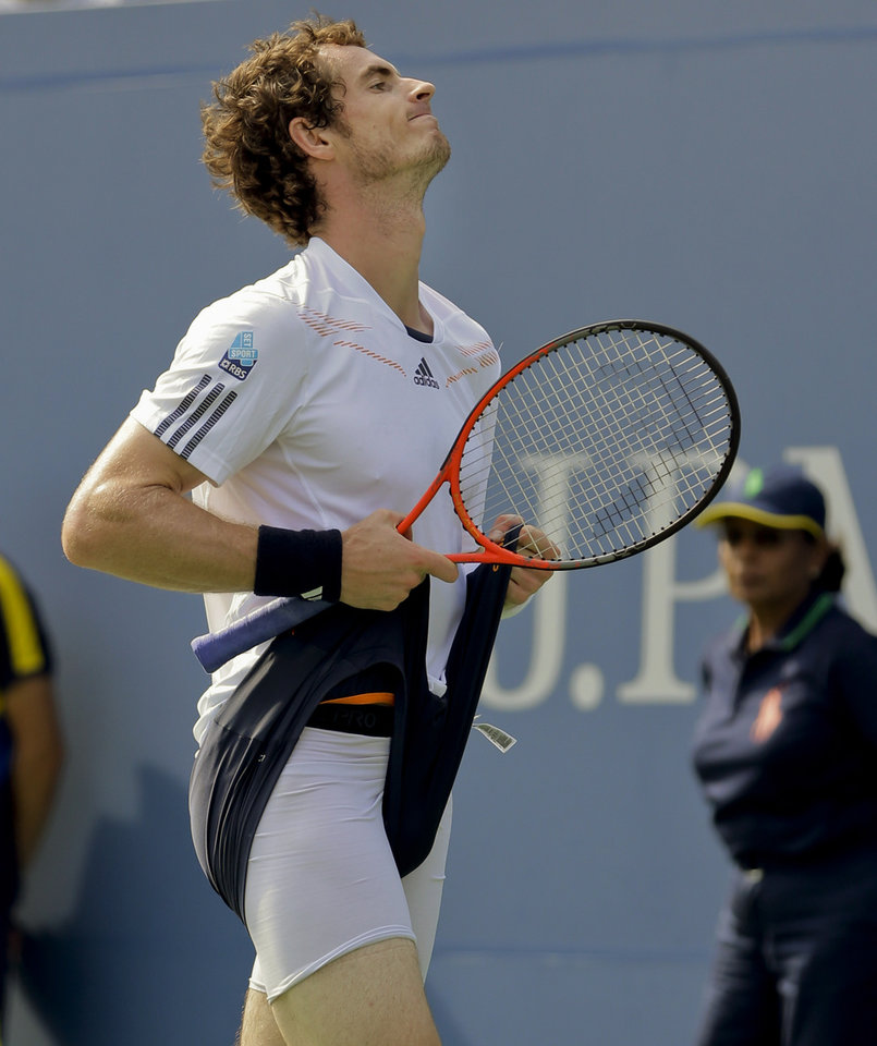 Photo -   Britain's Andy Murray reacts while playing against Czech Republic's Tomas Berdych during a semifinal match at the 2012 US Open tennis tournament, Saturday, Sept. 8, 2012, in New York. (AP Photo/Mike Groll)