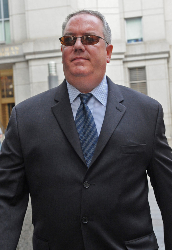 Photo - FILE - In this  June 21, 2011 file photo, Jerome O'Hara, former computer programmer for Bernard L. Madoff Investment Securities, leaves Manhattan federal court.  He is one of five former employees of imprisoned financier Bernard Madoff  convicted Monday, March 24, 2014 in New York, at the end of a six-month trial that portrayed them as telling an elaborate web of lies to hide a fraud that enriched them and cheated investors out of billions of dollars. (AP Photo/Louis Lanzano, File)