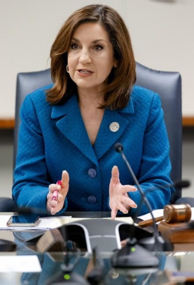 Photo -  Oklahoma State Superintendent of Public Instruction Joy Hofmeister speaks during an emergency meeting of the Oklahoma State Board of Education in Oklahoma City on Monday to announce the closing of public schools until April 6 to combat the spread of the coronavirus.  [Chris Landsberger/The Oklahoman]