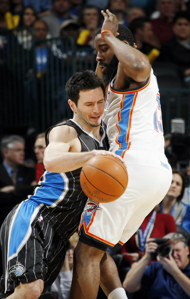 Photo - Orlando's J.J. Redick (7) collides with James Harden (13) of Oklahoma City during the NBA basketball game between the Orlando Magic and Oklahoma City Thunder in Oklahoma City, Thursday, January 13, 2011. Harden was called for a foul on the play. Photo by Nate Billings, The Oklahoman