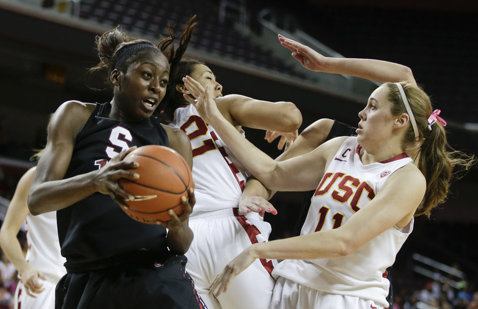 Stanford forward Chiney Ogwumike, left, pulls a rebound away from Southern California forward Cassie Harberts, right, and Kiki Alofaituli during the second half of an NCAA women's basketball game in Los Angeles, Friday, Feb. 15, 2013. Stanford defeated Southern California 79-55.  (AP Photo/Chris Carlson)
