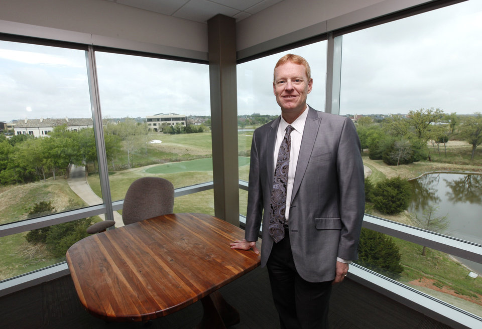 Photo -  Marty Hepp, senior partner and chief executive of CEC Infrastructure Solutions, stands in his office, which overlooks Gaillardia Golf Course. Photo by Paul Hellstern, The Oklahoman   PAUL HELLSTERN -  Oklahoman