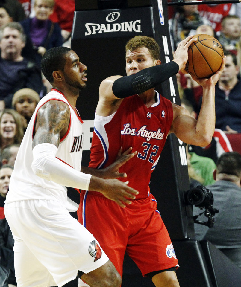 Los Angeles Clippers forward Blake Griffin, right, looks for an outlet pass against the defense of Portland Trail Blazers forward LaMarcus Aldridge during the first quarter of their NBA basketball game in Portland, Ore., Thursday, Nov. 8, 2012. (AP Photo/Don Ryan)