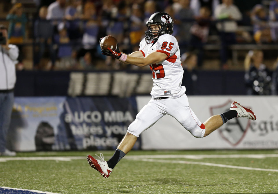 Photo - Yukon's Codey Sanchez catches a touchdown pass against Edmond North during a high school football game at Wantland Stadium in Edmond, Okla., Thursday, October 4, 2012. Photo by Bryan Terry, The Oklahoman