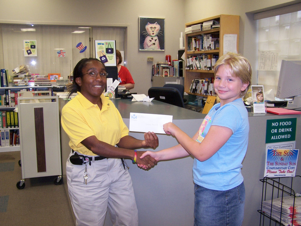 Dee McDaniel, Extension Specialist at the Harrah Library presenting Lindsey Fijalka with her gift card<br/><b>Community Photo By:</b> Audrey Heise-Fijalka<br/><b>Submitted By:</b> Audrey, Harrah