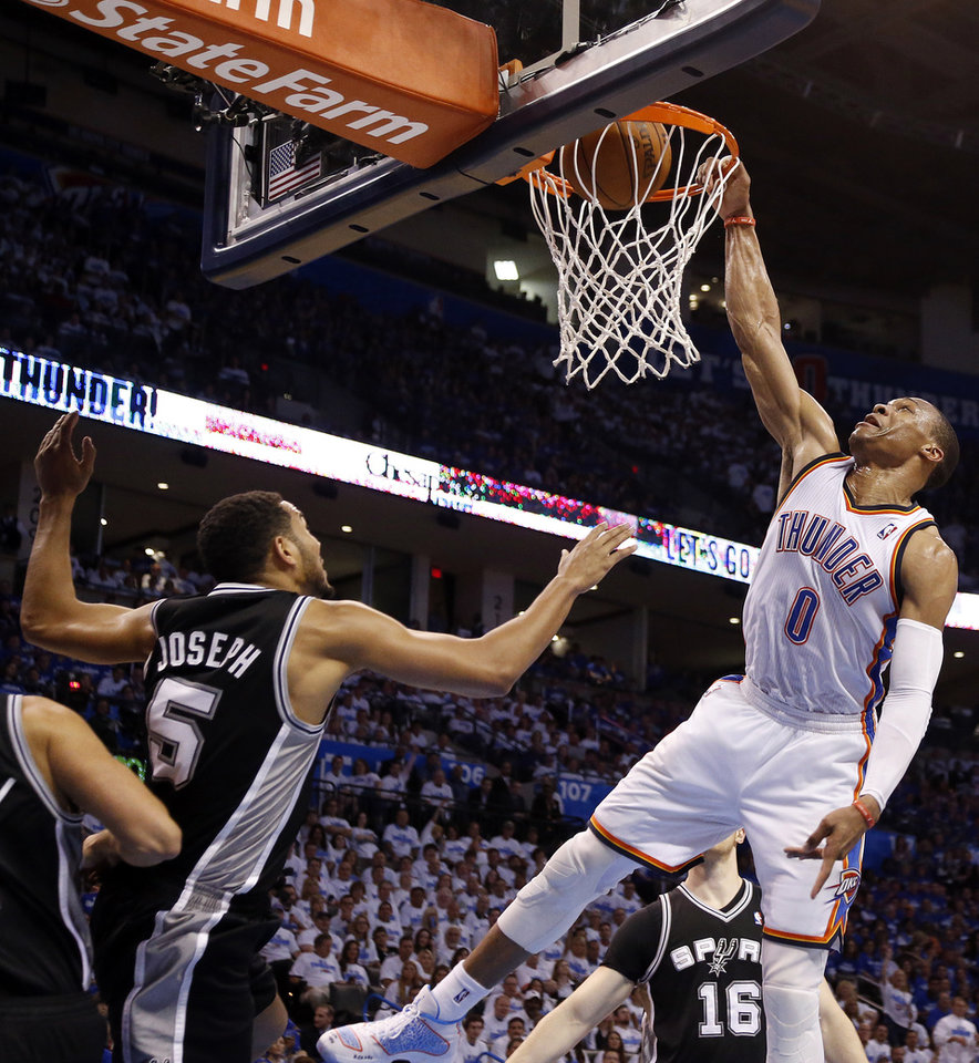 Oklahoma City's Russell Westbrook (0) dunks in front of San Antonio's Cory Joseph (5) during Game 4 of the Western Conference Finals in the NBA playoffs between the Oklahoma City Thunder and the San Antonio Spurs at Chesapeake Energy Arena in Oklahoma City, Tuesday, May 27, 2014. Photo by Nate Billings, The Oklahoman