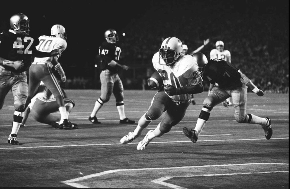 Photo - ADVANCE FOR NOV 18 --FILE--- Nebraska's Heisman trophy winner Johnny Rodgers (20) scores a touchdown in the Orange Bowl in Miami against Notre Dame on Jan. 1, 1973.  Rodgers scored four touchdowns, an Orange Bowl record, during a game in 1994.   He has been chosen for The Associated Press All-Time Big Eight football team.  He was selected by a panel of a dozen longtime observers who looked back over 36 years of conference football in the Big Eight's final year to pick an all-time team.  But, many prominent names could not be squeezed onto the 25-player list. (AP Photo, fls)   - Associated Press