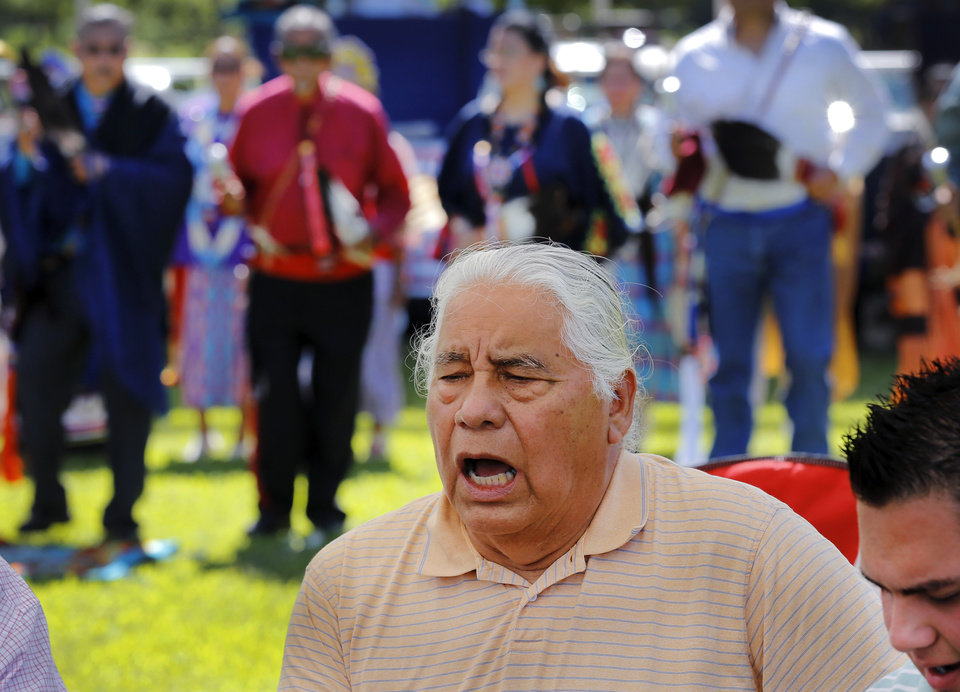 Photo -  Victor White sings and drums for the dancers. White, from McLoud, said he has many friends who belong to the Tinker Inter-Tribal Council. He said this was his first time to participate in their activity. Photo by Jim Beckel, The Oklahoman   Jim Beckel -