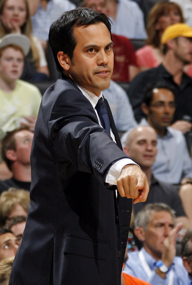 Photo - Miami head coach Erik Spoelstra gives instructions to his team during the NBA basketball game between the Miami Heat and the Oklahoma City Thunder at Chesapeake Energy Arena in Oklahoma City, Sunday, March 25, 2012. Photo by Nate Billings, The Oklahoman