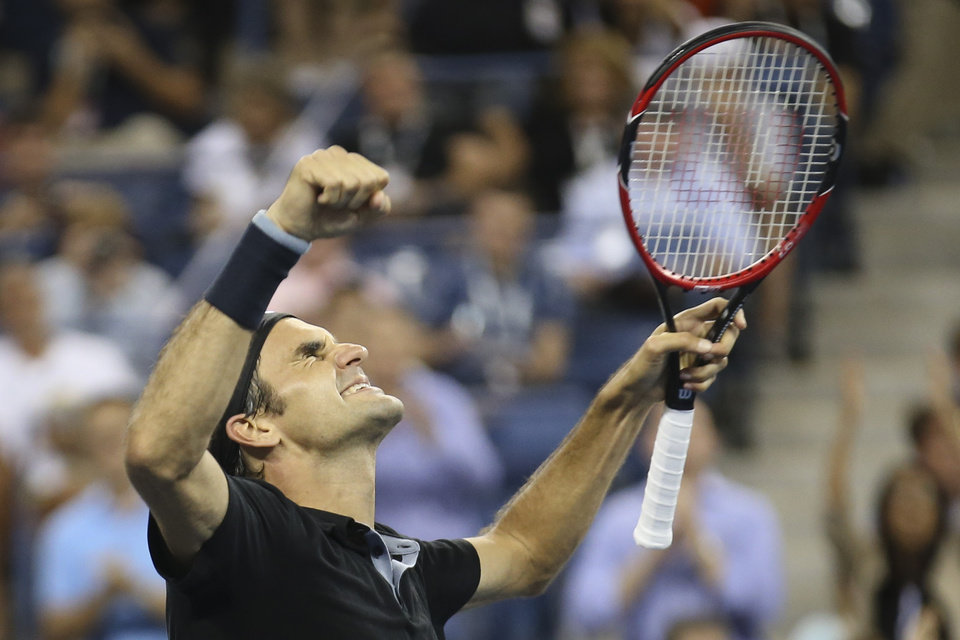 Photo - Roger Federer, of Switzerland, celebrates after defeating Gael Monfils, of France, 4-6, 3-6, 6-4, 7-5, 6-2 during the quarterfinals of the U.S. Open tennis tournament, Thursday, Sept. 4, 2014, in New York. (AP Photo/John Minchillo)