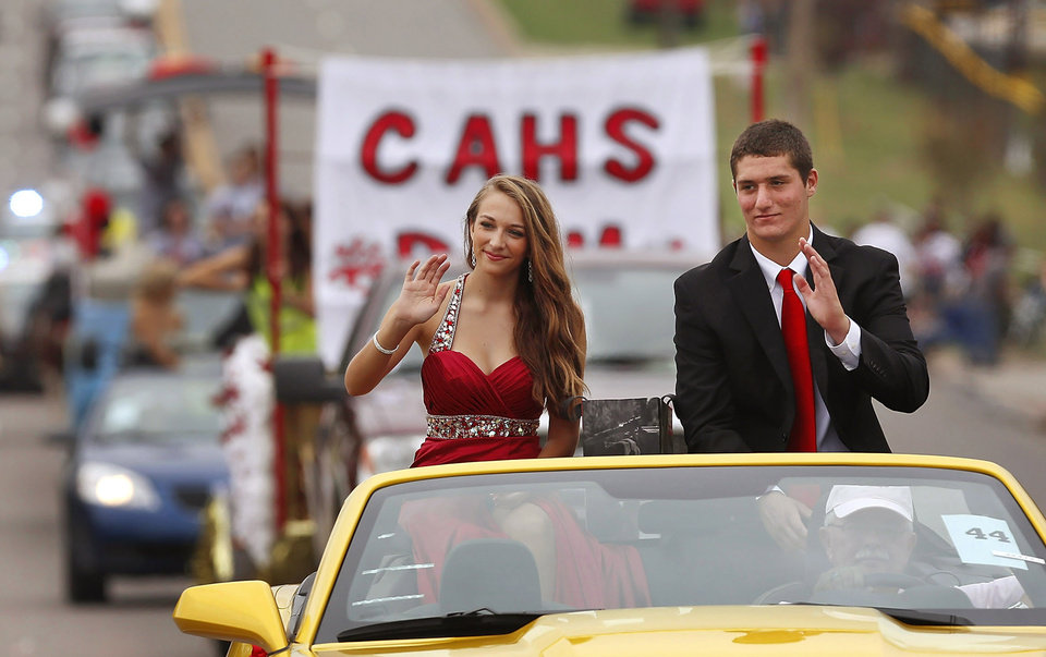 Cory McCalister, right and Brooklynn Payne ride in the car sponsored by the CAHS pom-pon squad. Payne was crowned Homecoming Queen at the game later in the day. Carl Albert High School is celebrating its 50th birthday this year and students and alumni participated in homecoming week activities, including a two-mile long parade before the football game on Friday, Oct. 12, 2012. Photo by Jim Beckel, The Oklahoman